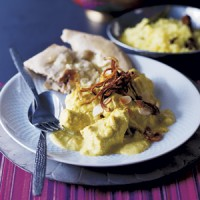 Creamy chicken curry with fried onions and flaked almonds recipe