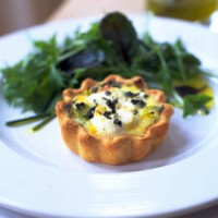 Leek and goats cheese quiche with a salad of fresh leaves recipe