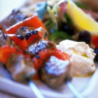 Houmous-griddled lamb with red peppers and olives recipe