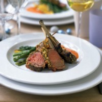 Rack of lamb with a garlic and herb crust served with red pepper sauce, polenta and griddled asparagus recipe