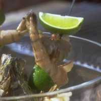 Sticky sizzling prawns with lime and caraway seeds recipe