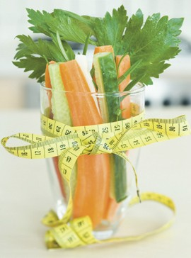 Vegetables with measuring tape-diets on test-diet tips-weight loss-woman and home