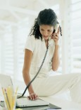 Fireproof Your Job-woman on phone-career advice-lifestyle-finance-woman and home