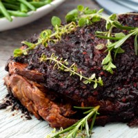 Slow-roasted lamb shoulder with honey, herbs and harissa recipe