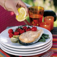 Baked salmon steaks with French beans, cherry tomatoes and artichokes recipe