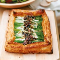 Asparagus tart with Brie and black olive dressing recipe