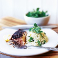 Grilled salmon with sumac, and courgette, mint and pea risotto recipe