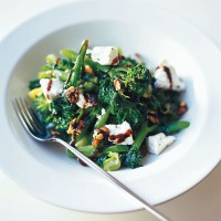 Stir-fried greens with goats cheese and walnuts recipe