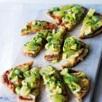 Pitta pizzas with melted brie, avocado and green grapes recipe
