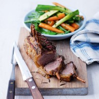 Roast rack of lamb with spring veg and hot herby dressing recipe