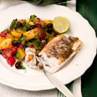 White fish with mango, black olive and tomato salsa recipe