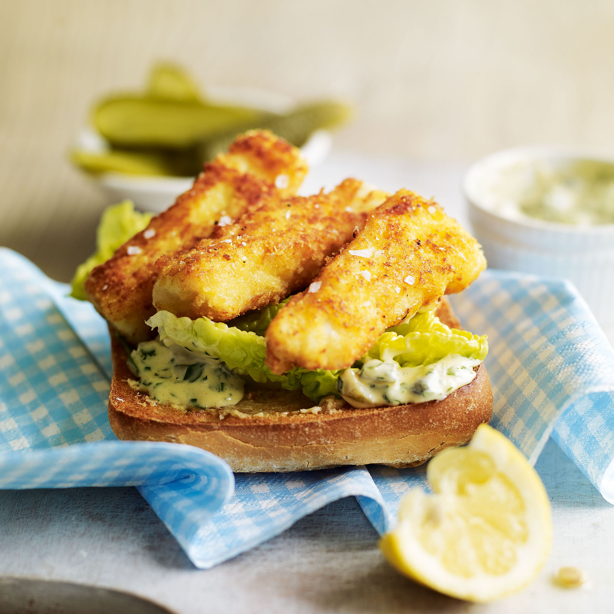 Homemade fish finger sandwich with tartare sauce woman for Fish sandwich recipe