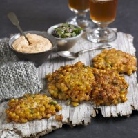 Sweetcorn fritters with harissa yogurt and lime salsa recipe