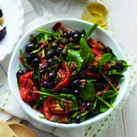Slow-roasted tomato, bacon and spinach salad recipe
