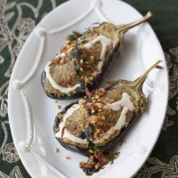 Grilled aubergine spread topped with creamy whey, fried onions, garlic, mint and walnuts recipe