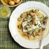 Roasted hake with buttery clam sauce