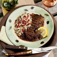 Rib-eye steaks with pomegranate couscous
