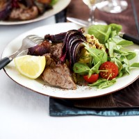 Sumac lamb with houmous and roasted red onions