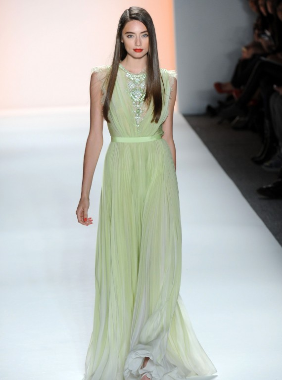 Model on the catwalk in pale green Jenny Packham dress