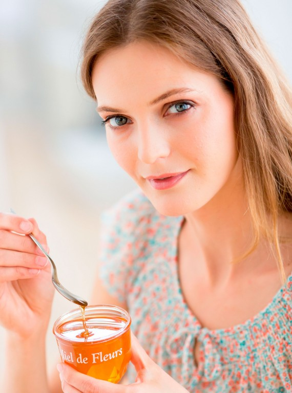 woman eating honey photo