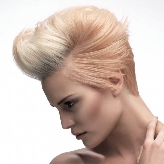 Photo of a model with a blonde quiff hairstyle