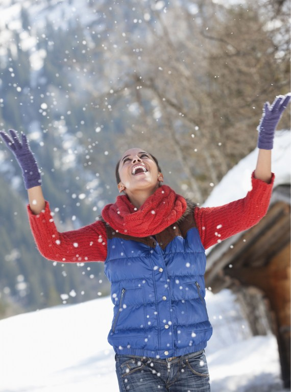 woman throwing snow photo