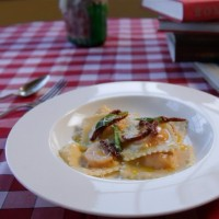 Butternut squash ravioli with fried sage leaves and sun-dried tomatoes