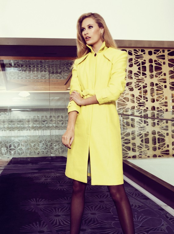 Photo of a model in a yellow trench coat