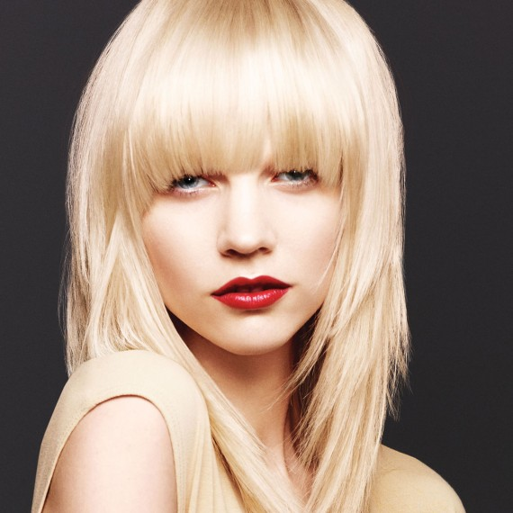 Photo of a model with a long blonde hairstyle with fringe