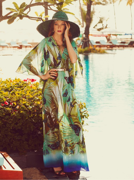 Photo of a model by the pool in a maxi dress