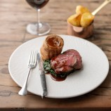 Treacle-cured beef and roast potatoes with Yorkshire puddings