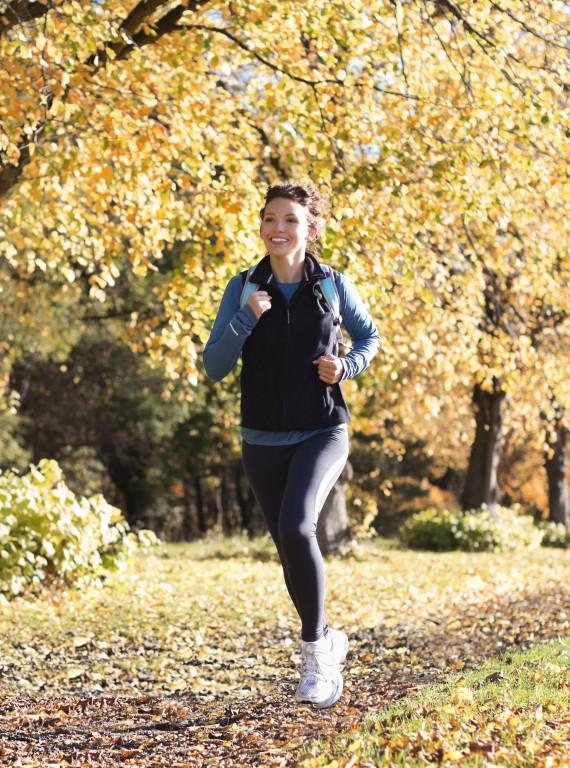 photo of woman running autumn