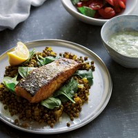 Tandoori salmon with spiced lentils and raita